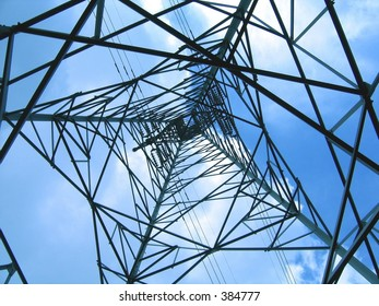 High Voltage Power Mast -- large iron structure set against the sky