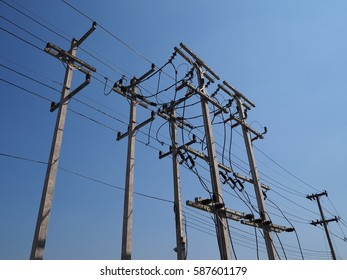 High voltage power pole with equipment and blue sky