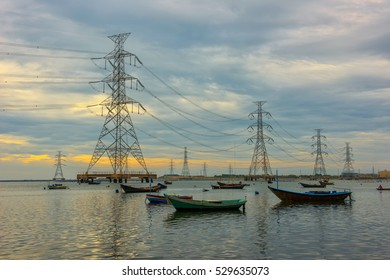 High voltage power pole in the sea and sky background.transmission tower.Electricity pylon. Clouds and morning light.