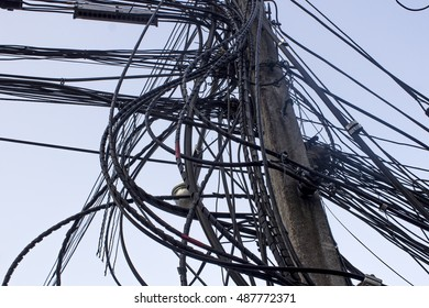 High voltage power pole with wires tangled