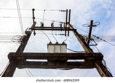 High voltage power pole with wires tangled,Wire and cable clutter.