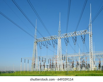High voltage power substation on blue sky background.