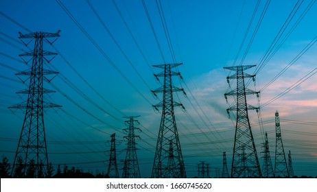 High voltage power tower and beautiful nature landscape at sunset