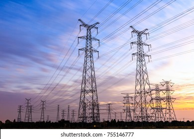 High voltage power tower landscape at sunset