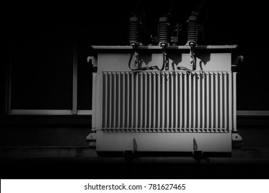 High voltage power transformer in the city - monochrome