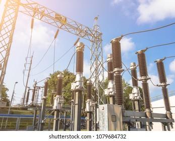 High voltage power transformer substation 115KV.high-voltage substation on blue sky background with switch.High voltage substation in the plant industry.