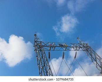 High voltage power transformer substation 115KV.high-voltage substation on blue sky background.High voltage substation in the plant industry.