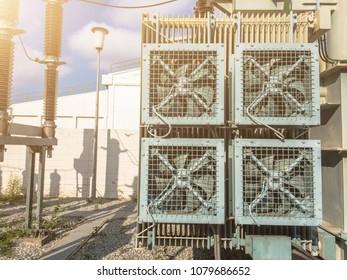 High voltage power transformer substation 115KV.high-voltage substation on blue sky background with switch.fan for Cooling High voltage power transformer.High voltage substation in the plant industry.