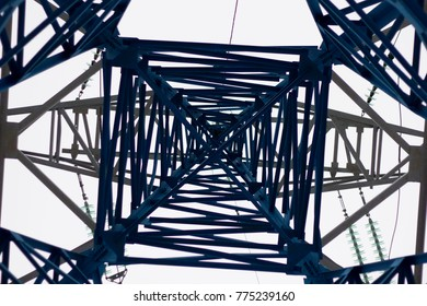 High voltage pylon on skies background, Transmission line tower, bottom View