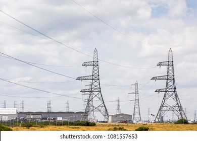 High voltage pylons at Dungeness Nuclear Power Station, Romney Marsh, Kent, England.