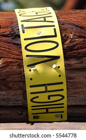 high voltage sign on removed broken utility pole