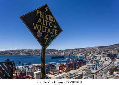 A high voltage sign and view at the city of Valparaiso from the Ascensor Artilleria elevator, Valparaiso, Chile (South America)