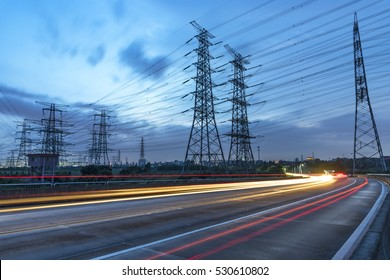 High voltage, high speed road car track in the background of high voltage towers