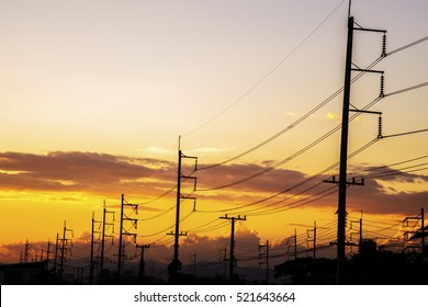 High voltage tower of colorful sky at evening