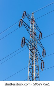 High voltage tower (electricity post), deep blue sky.