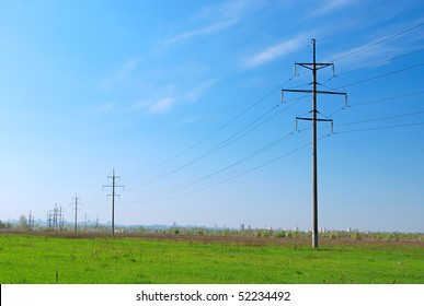 high voltage tower on sky background