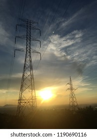 High voltage tower with sunset