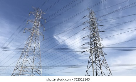 High voltage towers with sky background. usually a steel lattice tower, used to support an overhead power line. addition to steel, other materials may be used, including concrete and wood.