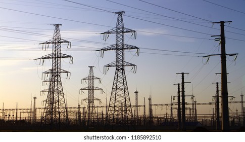 High voltage towers with substation with sky background - industrial image