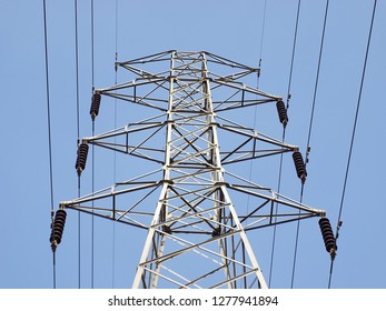 High voltage transmission line on the pole: is a system with a voltage between over 1,000 volts. It can deliver far electricity and lose less power than a low voltage power system.