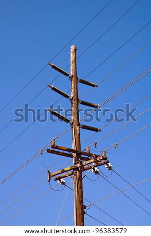 High voltage transmission lines on a post in Kauai, Hawaii