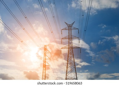 High voltage transmission lines with sky background.