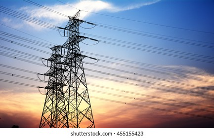High voltage transmission tower at dusk