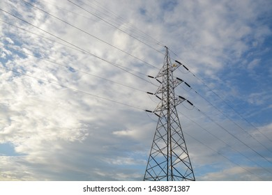 High voltage transmission tower or power tower (electricity pylon) and electrical distribution substation with Blue sky Background
