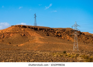 High voltage transmission towers for electricity in Sahara desert in Morocco, Africa