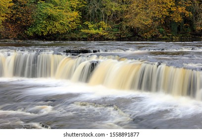 High volumes of water crossing Aysgarth Upper Falls Yorkshire Dales