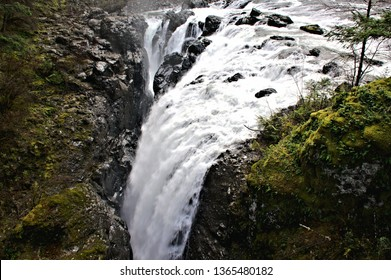 High volumes of water rushing over the rock cliff edges only to disappear into a crevice where the journey of water will continue down below heading further downstream to reach the ocean water