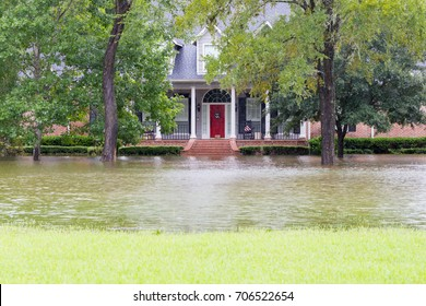 High water and flooded house in Houston suburbs during Hurricane Harvey