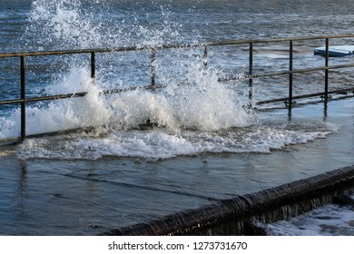high water is flooding  the quay with spray and splashes, storm in the baltic sea in Travemuende, Germany, copy space
