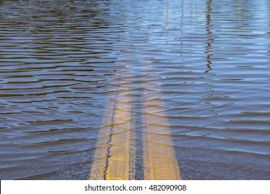 High Water Street Flooding Over Bridge