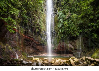 High waterfall at levada 25 fontains - one of the most popular touristic hiking routes at Madeira island. Rabacal, Portugal.