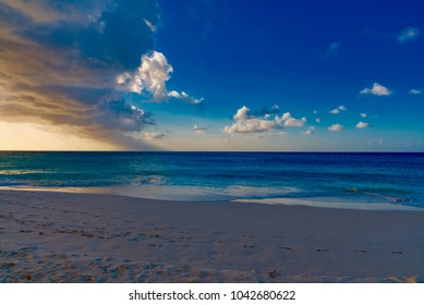 High waves of the Atlantic ocean on the beach of the Caribbean sea at sunset