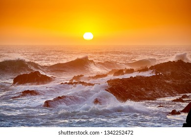 High waves at beautiful sunset in tsitsikama national park, south africa