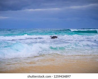 High waves breaking on the shore at Corralejo dune beach at Fuerteventura, Spain