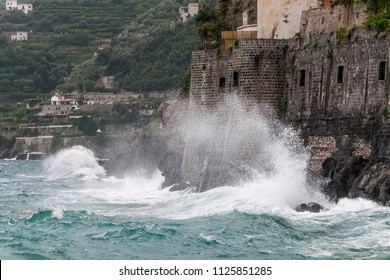 High waves crash violently on the coast, Minori, Costiera Amalfitana, Campania, Italy