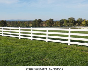 high white fence by a field