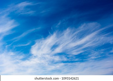 High white wispy cirrus clouds with cirro-stratus in the blue Australian sky  sometimes called mare's tails  indicate fine weather now but stormy changes coming within a couple of days.