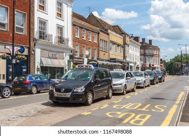 High Wycombe, UK - 3rd June 2018: Taxi cabs lines up at a taxi rank on High street. The official rank is where taxis are allowed to wait for passengers.