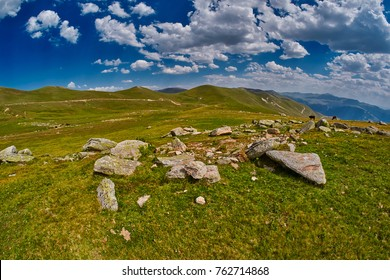High-altitude abstract mountain landscape with rocks and valleys in the background