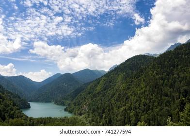 High-altitude lake Ritsa in Abkhazia in summer on a sunny, hot day.