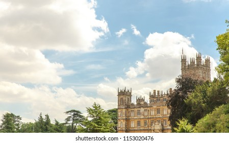 Highclere castle famous as downton abbey with green trees and blue sky background newbury England