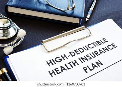 High-deductible health insurance plan HDHP on a desk.