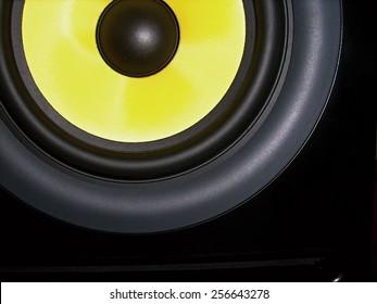 High-end black-yellow speaker, studio near-field monitor