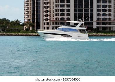 High-end cabin cruiser with open sedan bridge.
