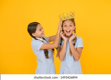 higher standard. vintage girls in gold crown. motivation to be the best. small egoist girls imagine they princess. success reward. happy childhood friendship. prom queen. retro look of selfish kids.