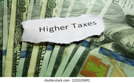 Higher Taxes message on hundred dollar bills